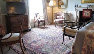 An antique Persian Kirman carpet in a Master Bedroom in Buckinghamshire