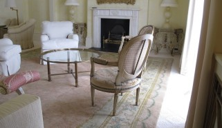 An early 20th century European Savonnerie carpet in a Belgravia Drawing Room