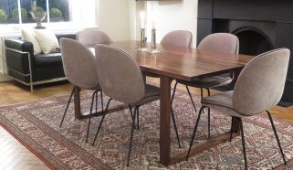 An antique Persian Jowshegan carpet in a mid 20th Century Dining Room
